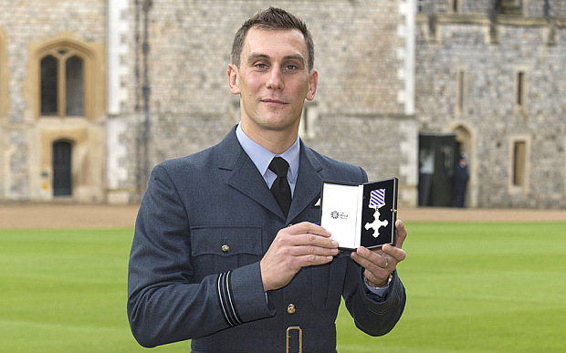Image for Queen gives RAF Chinook pilot DFC for Afghan heroism